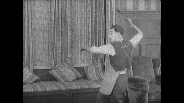 1917 Man (Buster Keaton) throws a knife at the chef who catches it in his mouth