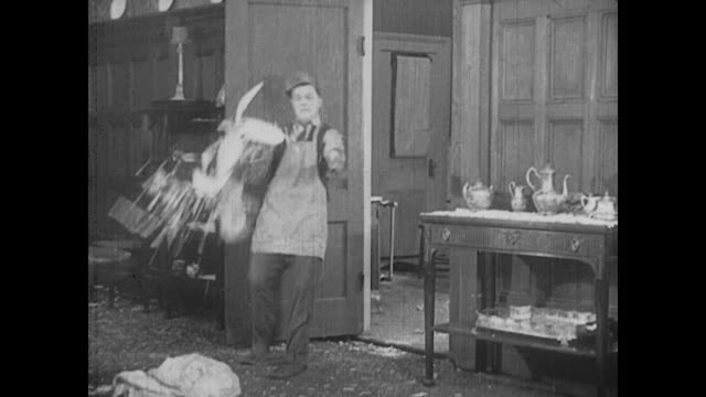 1917 Man (Fatty Arbuckle) throws dishes at another man (Buster Keaton)