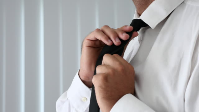 man tie a necktie - tie stock videos and b-roll footage