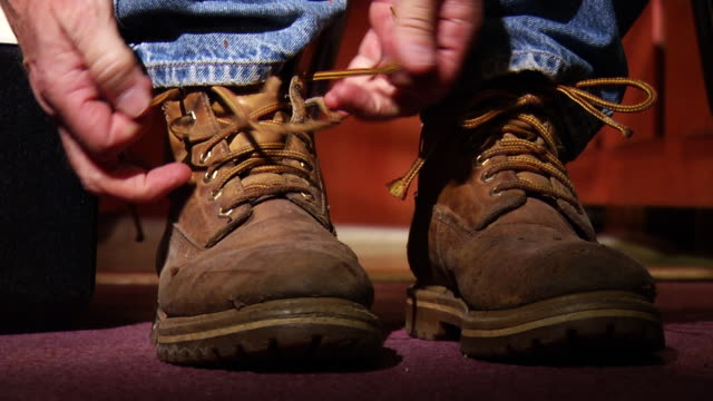 man ties work boots - tie stock videos & royalty-free footage