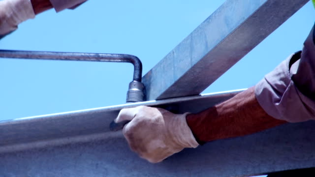 man tightening a bolt or screw using a socket - girder stock videos & royalty-free footage