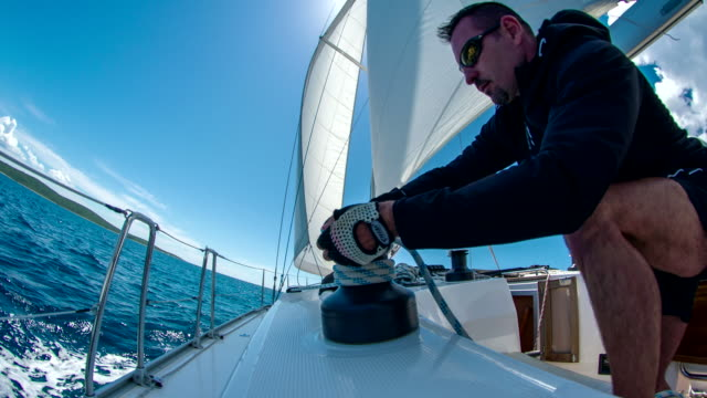 ms man tightening the sail - sailing boat stock videos and b-roll footage