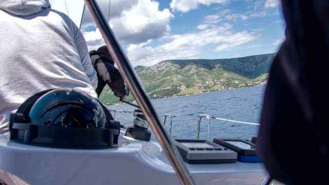 ms man tightening the sail - helm stock videos and b-roll footage