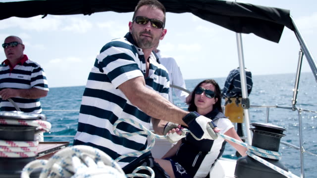 ms man tightening the sail - tights stock videos & royalty-free footage