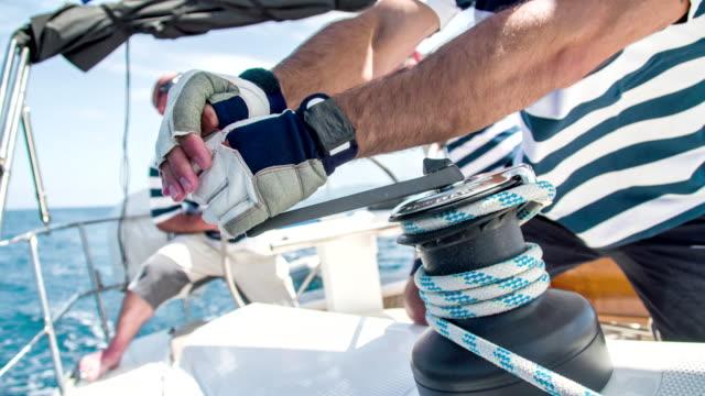 MS TU Man Tightening The Sail