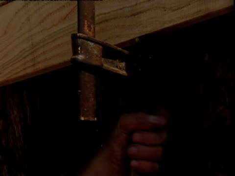 a man tightens a clamp. - ark stock videos and b-roll footage