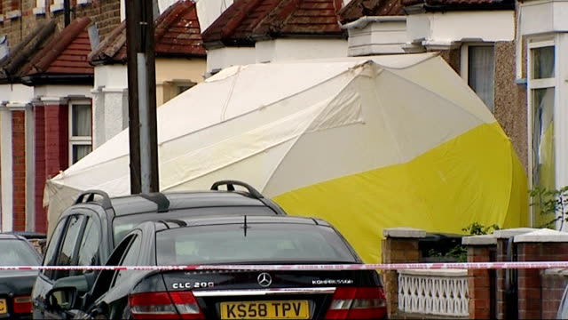 man to appear in court charged with the murder of malcolm boxall england london edmonton ext forensic officers police cordon tape and forensics tent... - 刺傷事件点の映像素材/bロール