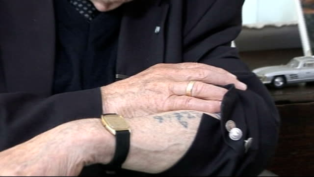 man to stand trial for nazi war crimes germany munich max mannheimer showing concentration camp number on arm and interview sot - konzentrationslager stock-videos und b-roll-filmmaterial