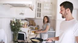 Man Tossing Pancake while Making Breakfast