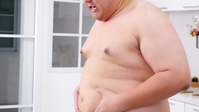 man touching his overweight belly and feel angry.real bodies - thick stock videos & royalty-free footage