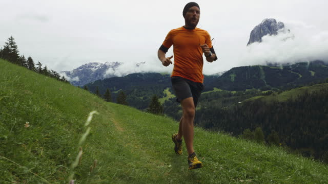 man trail running in the forest up mountain - footpath stock videos & royalty-free footage