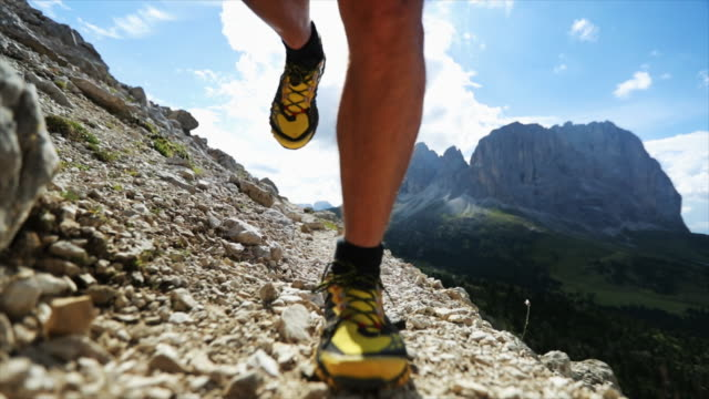 man trail running on dolomites high mountain - athleticism stock videos & royalty-free footage