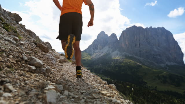 Man trail running on Dolomites high mountain