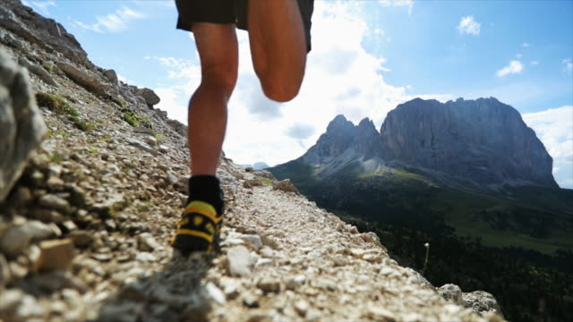 man trail running on dolomites high mountain - strada in terra battuta video stock e b–roll