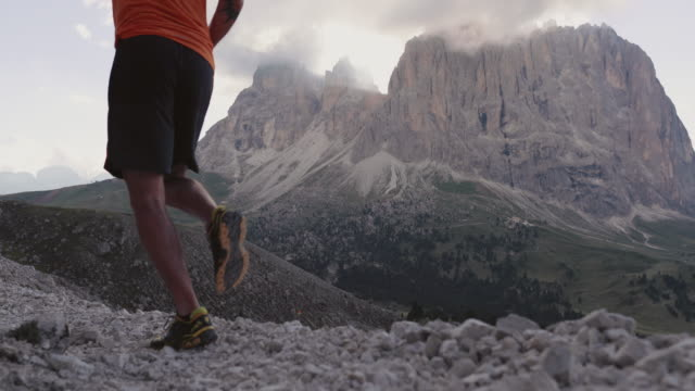 man trail running on mountain: the dolomites - named wilderness area stock videos & royalty-free footage