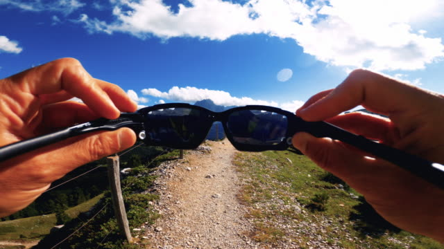 pov man trail running on mountain: wearing sunglasses - cross country running stock videos & royalty-free footage