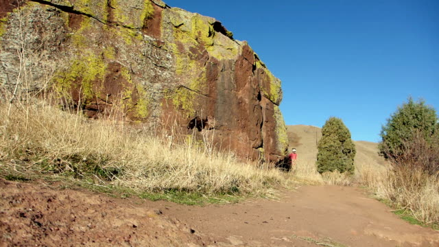 man trail runs red rocks park morrison colorado rocky mountains - red rocks stock videos & royalty-free footage