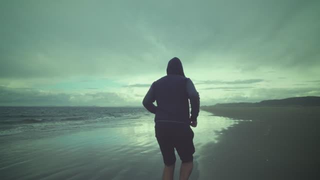 Man training at beach.