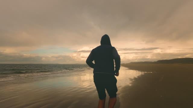 Man training at muriwai beach, Auckland.