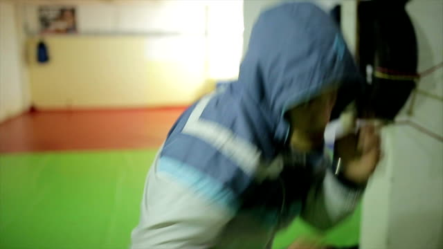 Man training, exercising at the  gym, fitness,boxing, sport, martial arts - …