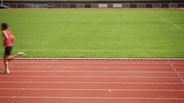 man training for triathlon - track and field event stock videos & royalty-free footage