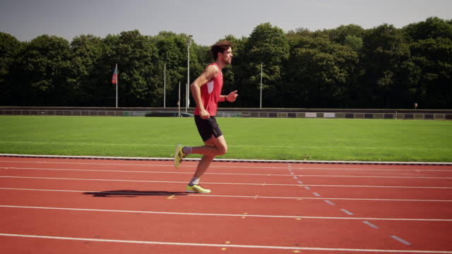 man training for triathlon - track and field event stock videos and b-roll footage