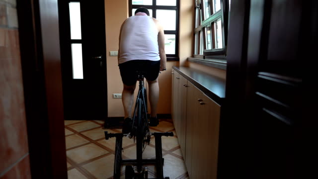 man training on cycle home trainer - exercise bike stock videos & royalty-free footage