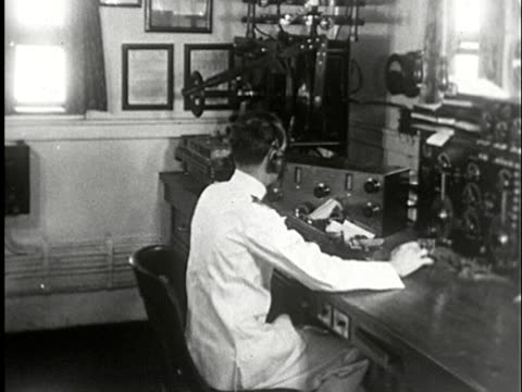 ms, composite, b/w, man transmitting message in morse code on telegraph machine - telegraph stock videos & royalty-free footage