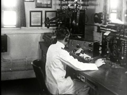 ms, composite, b/w, man transmitting message in morse code on telegraph machine - telegraph machine stock videos & royalty-free footage