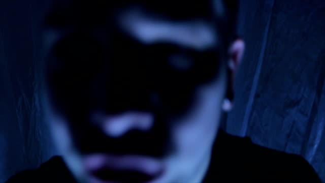 man trapped in a nylon covered room - follia video stock e b–roll