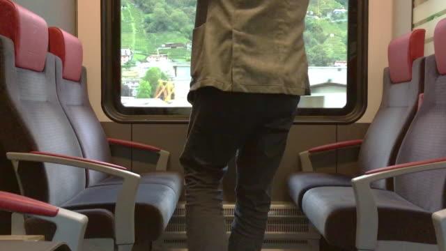man travel in a train - interno di treno video stock e b–roll