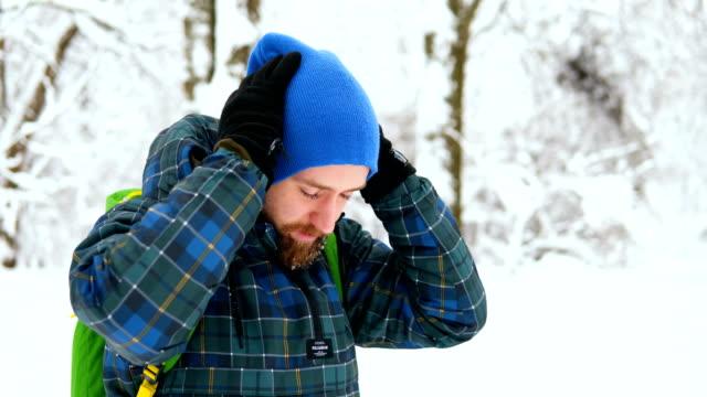 Man Traveler walking alone through snow mountains.