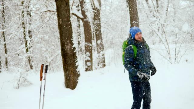 Man Traveler walking alone through the snow mountains.