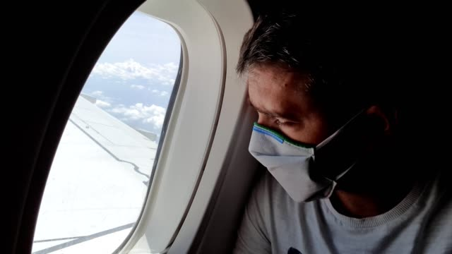 man traveling by plane during coronavirus epidemic - inside of stock videos & royalty-free footage