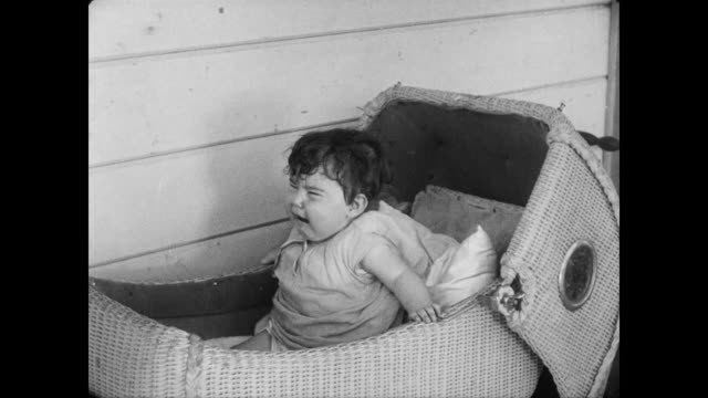 1928 A man (Buster Keaton) tries to calm a crying baby