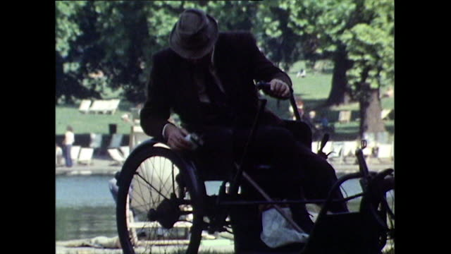 a man tries to fix squeaky three-wheeled wheelchair; 1971 - tricycle stock videos & royalty-free footage