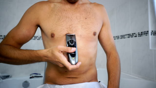 man trimming chest hair in bathroom - barechested bare chested stock videos and b-roll footage