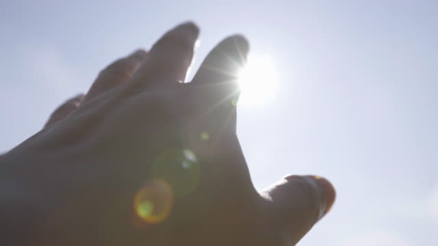 man try to grab the sun