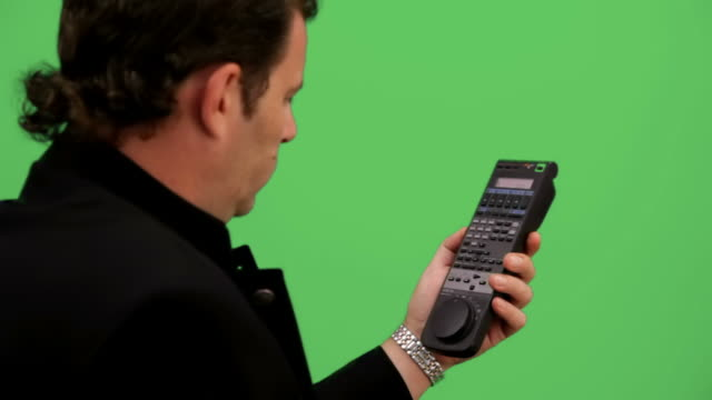 Man tunning remote control. Chroma key