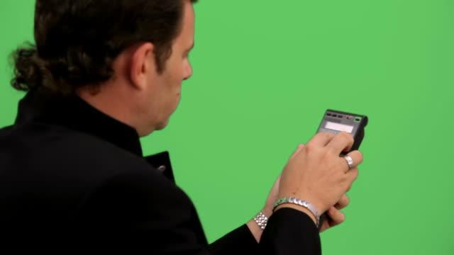 Man tunning remote control. Chroma key