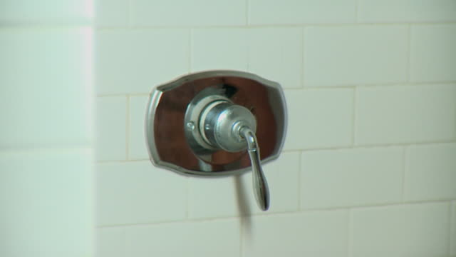 cu man turning shower on and off, close up of hand, panama city, panama  - knob stock videos and b-roll footage