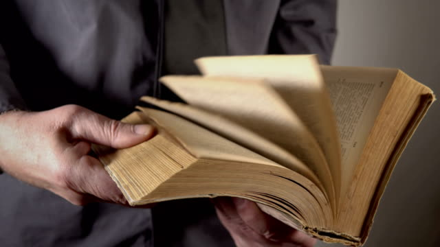 man turning yellow pages of vintage book - page stock videos and b-roll footage