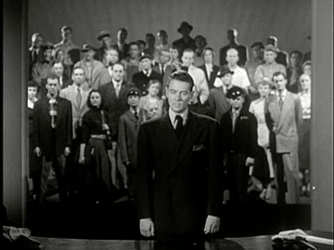 1952 b/w ls man turns around facing camera listening to voice / crowd representing cross-section of small town usa standing on risers   with, yeah, why not / usa/ audio - 1952 stock videos & royalty-free footage