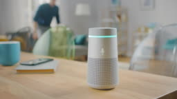 Man Turns On Smart Speaker that Activates Artificial Intelligence Assistant.