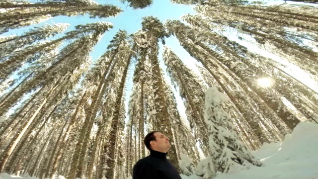 man twirling in the winter forest - one mid adult man only stock videos & royalty-free footage