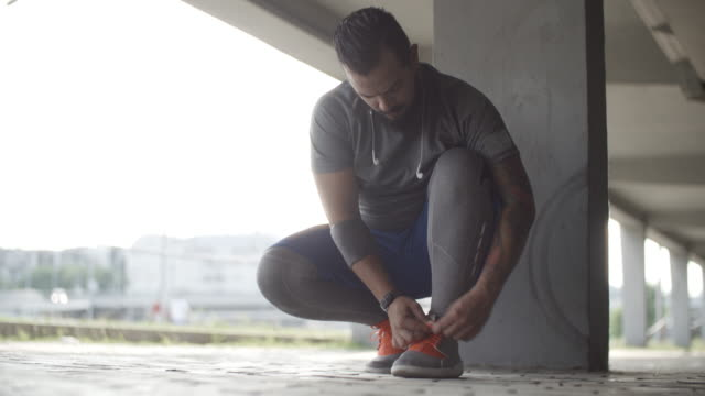 4K: Man Tying His Sport Shoes Laces.