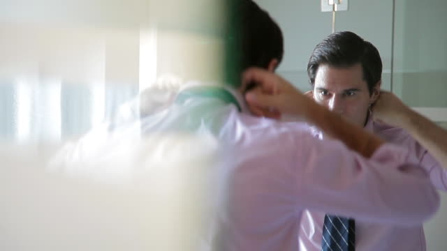 man tying tie in mirror - tie stock videos and b-roll footage