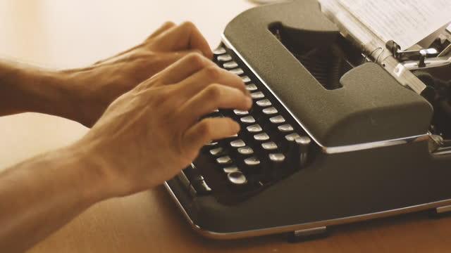 man types something with a typewriter - literature stock videos & royalty-free footage