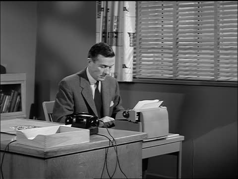 vídeos de stock, filmes e b-roll de b/w 1957 man typing at desk in office - vestuário de trabalho formal