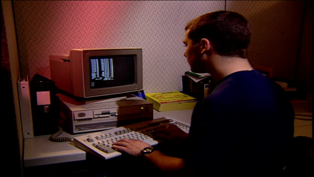 man typing on a 1990s desktop computer - 1995 stock-videos und b-roll-filmmaterial